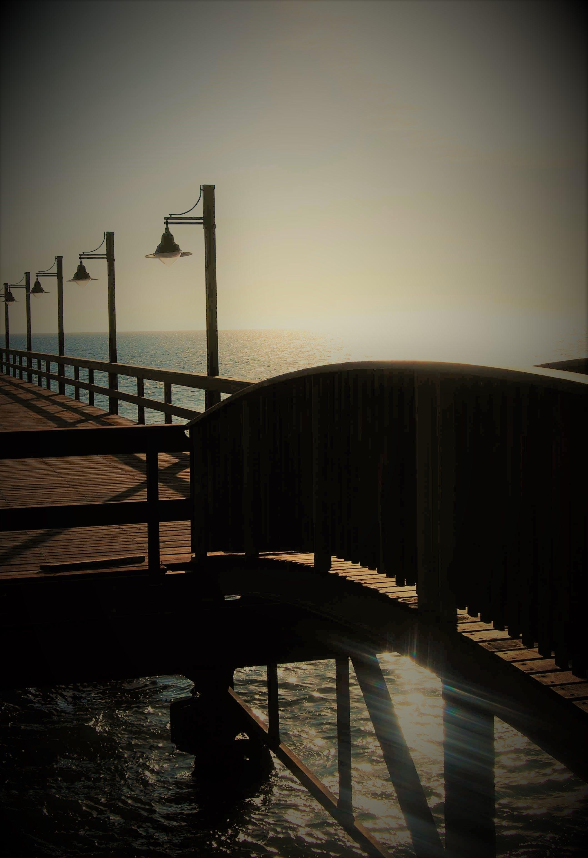 Free stock photo of Bridge Vintage Sunset Walk way Sea