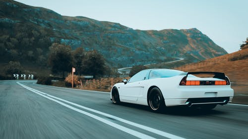 White Sports Car on the Road