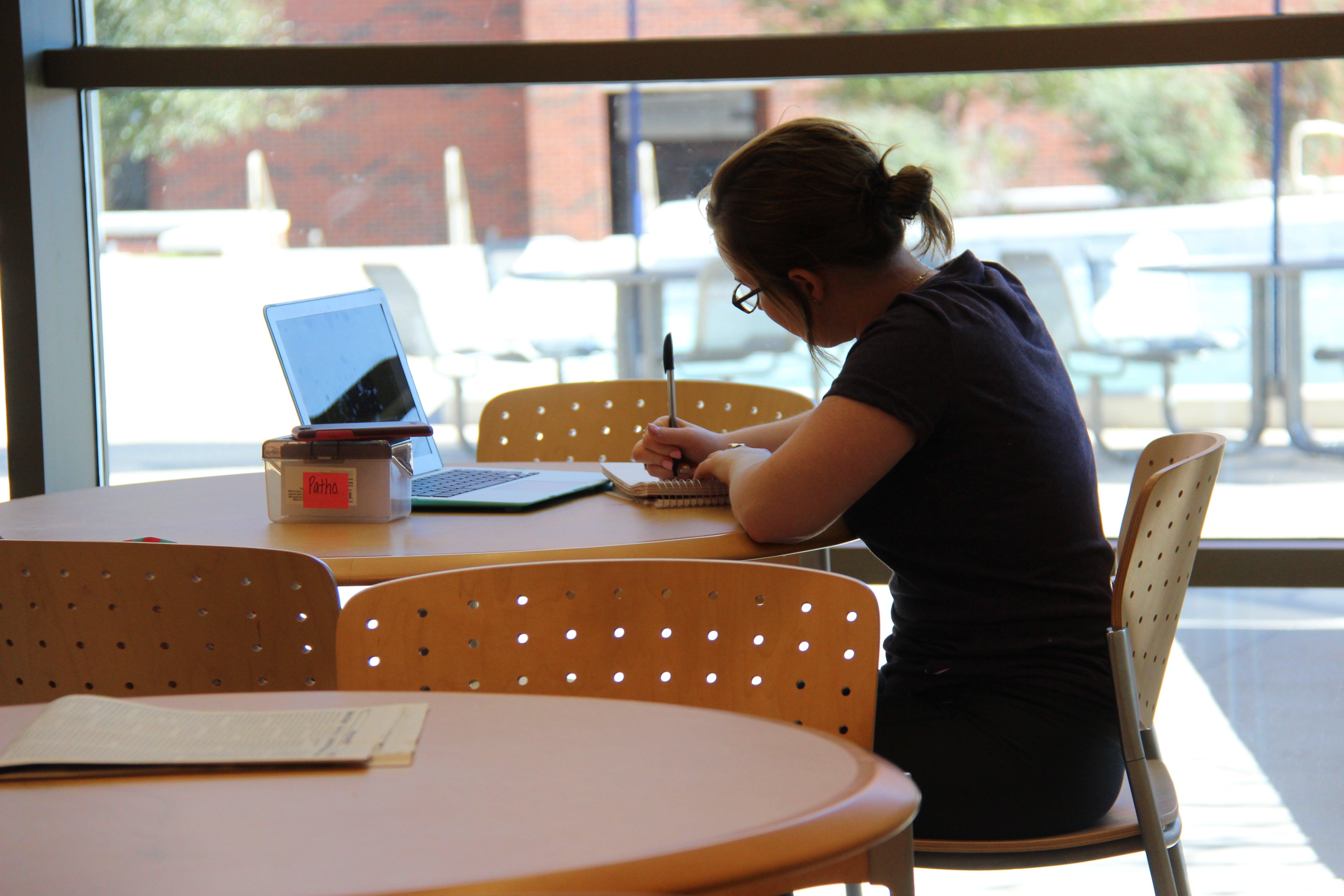 Free stock photo of college, girl, homework, laptop