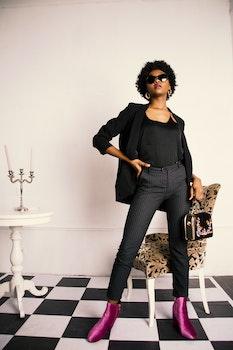 Woman in Black Blazer and Black Slacks With Purple Boots Photo