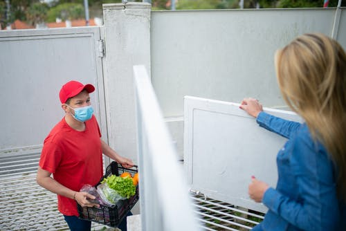 Delivery Man in Red Shirt Wearing a Face Mask