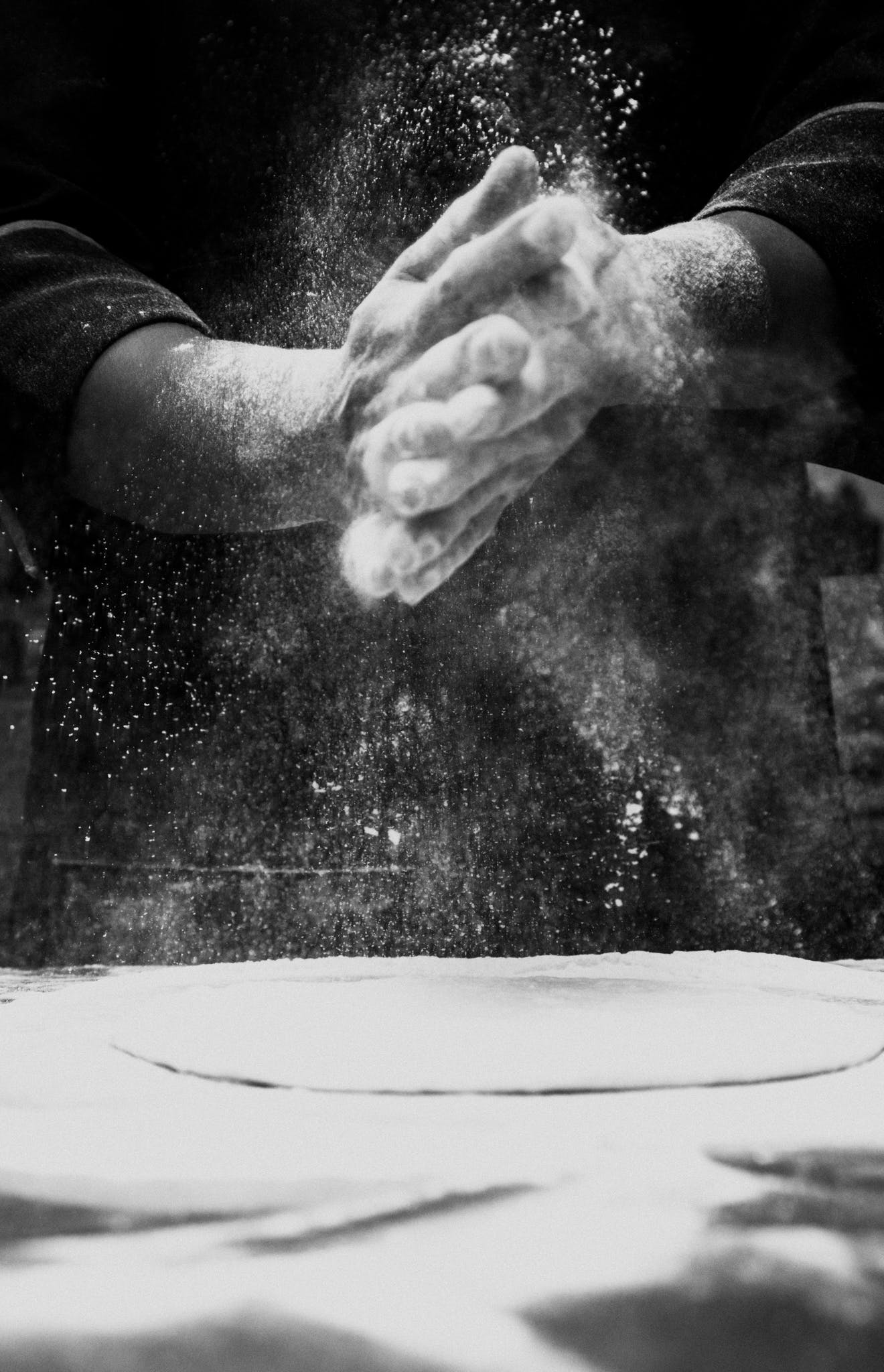 Person Spreading Flour