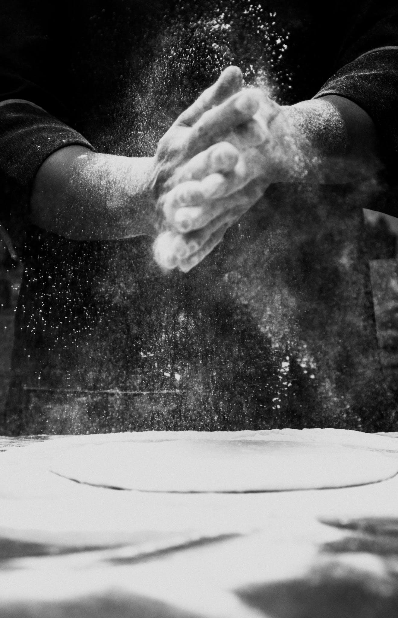Person Spreading Flour
