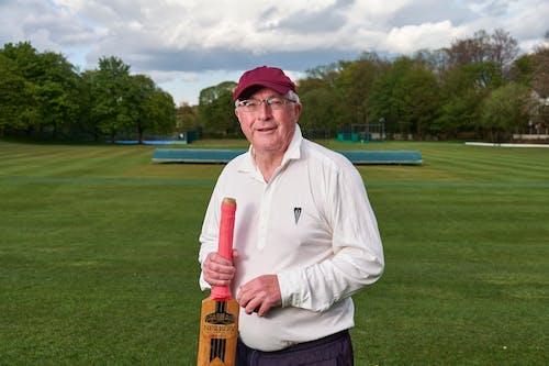 Elderly Man Holding a Cricket Bat