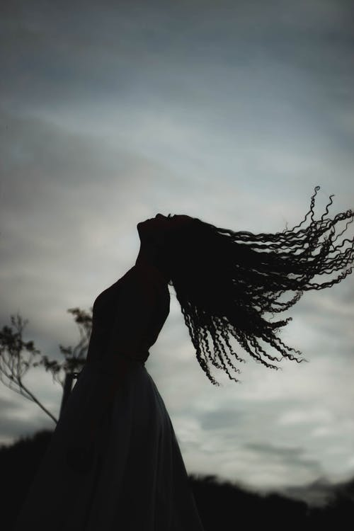 Silhouette of Woman in White Dress