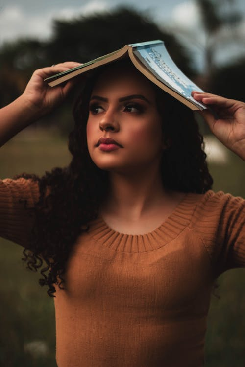 Free stock photo of book, curly hair, female model