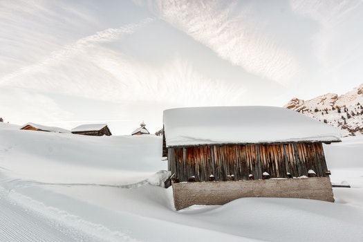 Photo of Concrete Houses Covered With Snow