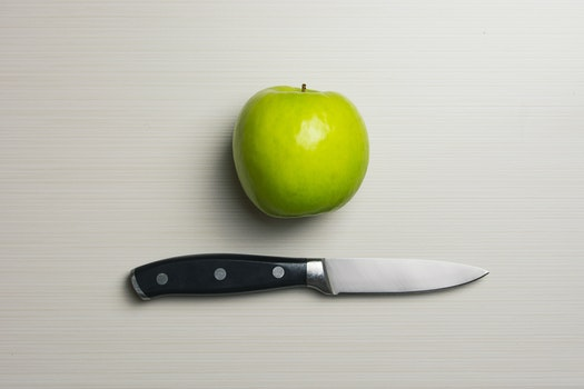 Green Apple Beside Silver Bladed Knife