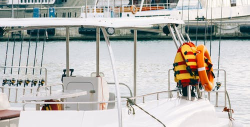 Photo of White Boat With Life Vest on Side
