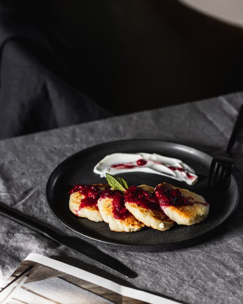 Sliced Tomato on Black Ceramic Plate