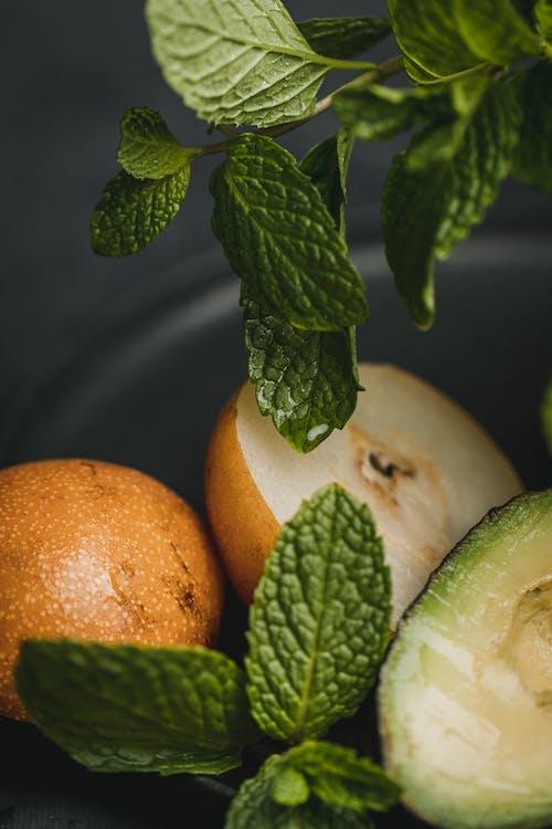 Orange Fruit on Black Round Plate