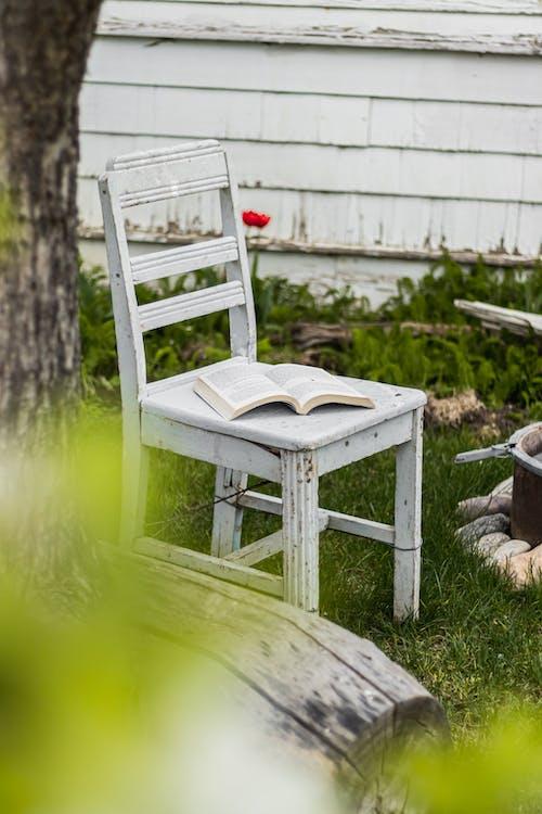 White Wooden Chair on Green Grass Field