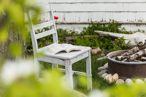 White Wooden Armchair on Green Grass Field