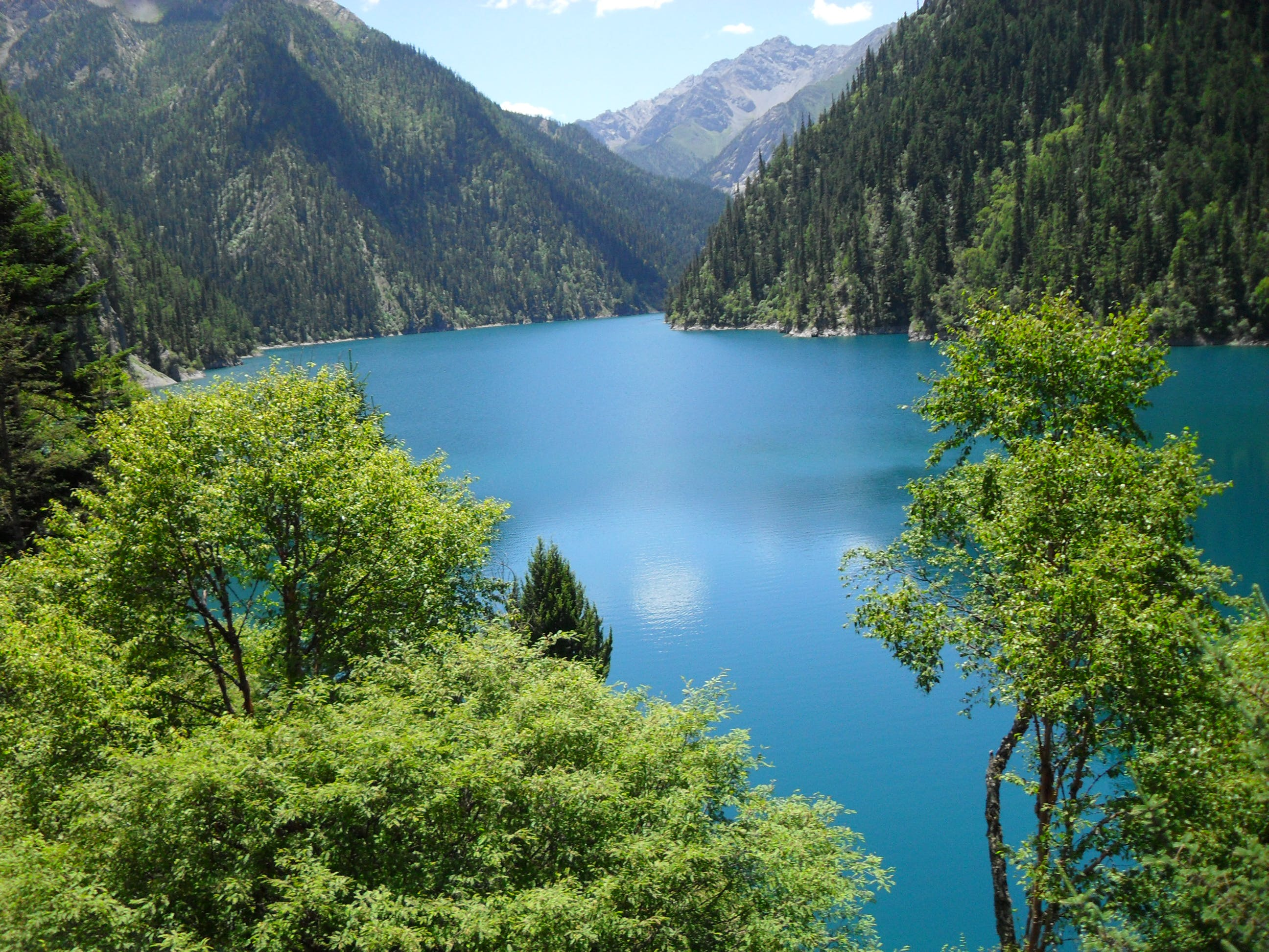 Blue Body of Water and Green Mountains Long Exposure Photography