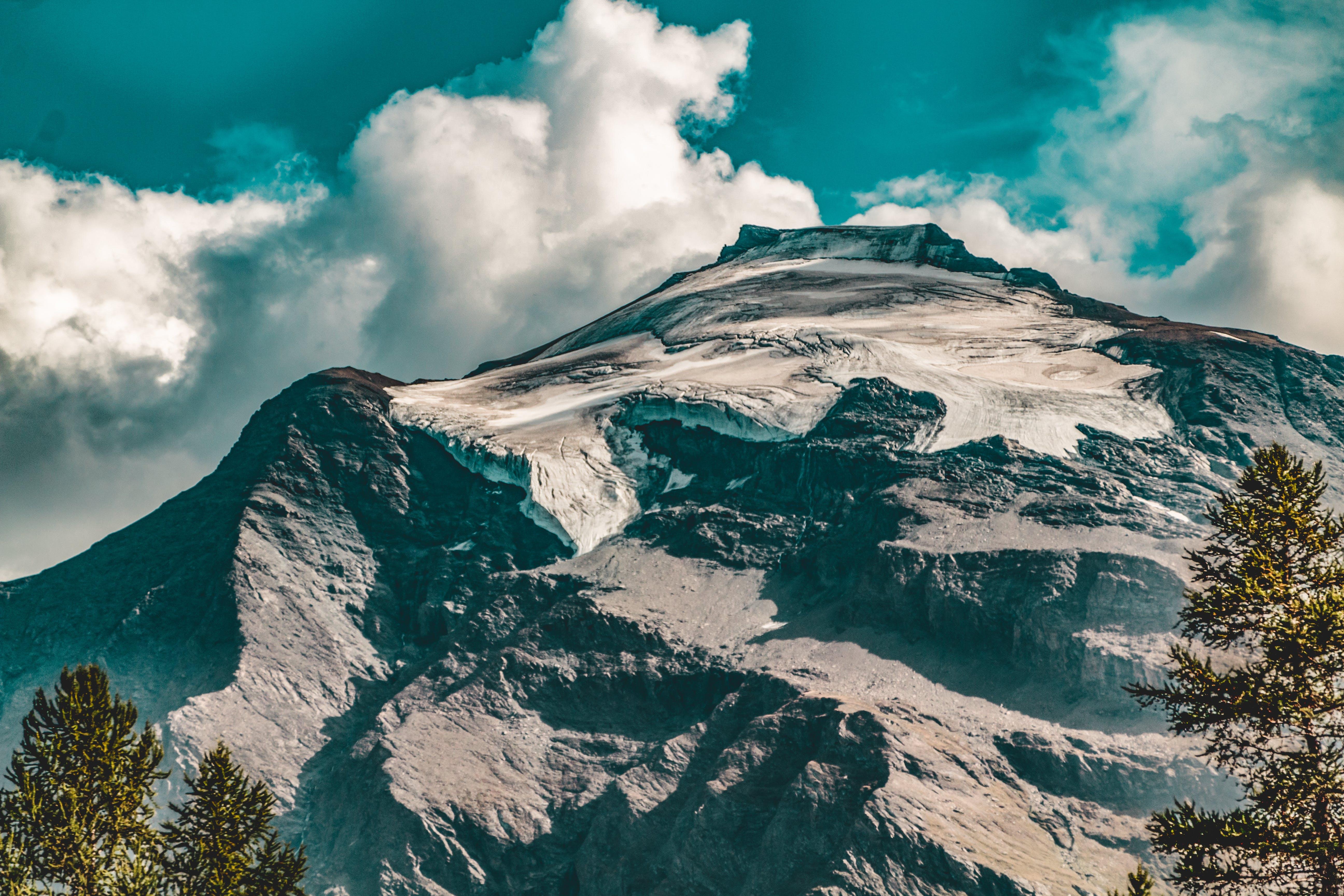 Rocky Mountain Under Blue Cloudy Sky
