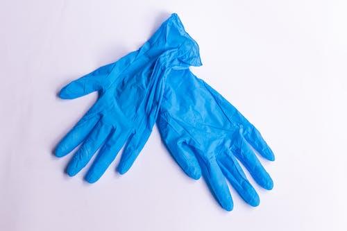 Fotos de stock gratuitas de desechable, equipo de protección personal, guantes de látex azul