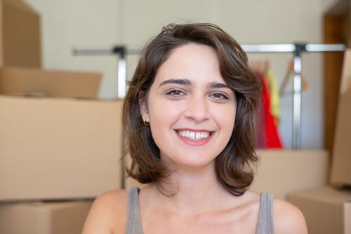 A Woman in a Gray Tank Top Smiling