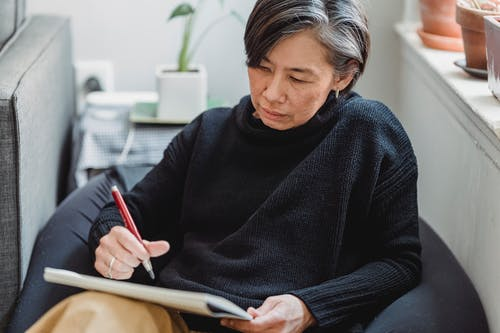 Woman Drawing an Artwork in a Sketchpad