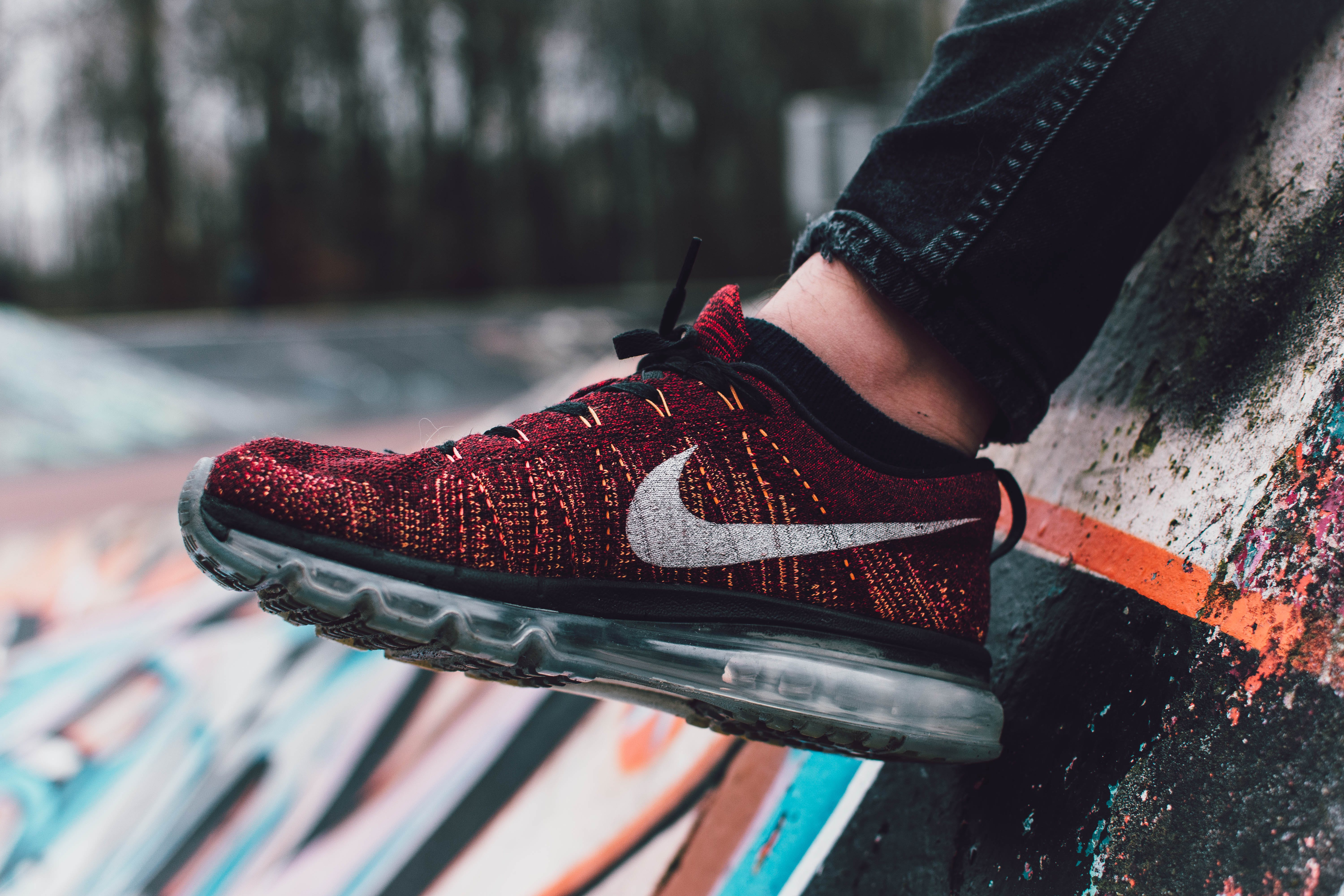 Close-Up Photography of Red and Black Nike Running Shoe