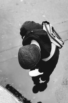 Monochrome Photography of a Person Wearing Beanie