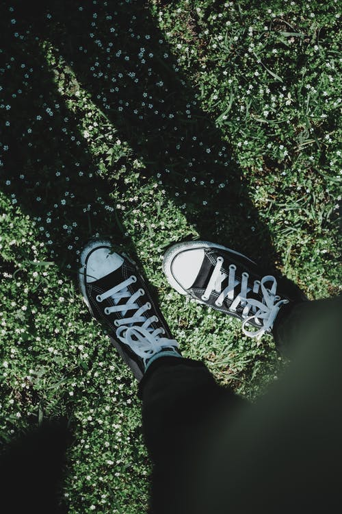 Person Wearing Black and White Sneakers