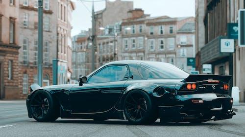 Black Porsche 911 Parked on Street