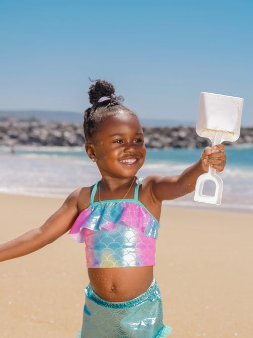 Girl in Pink and Blue Bikini Holding White Plastic Container