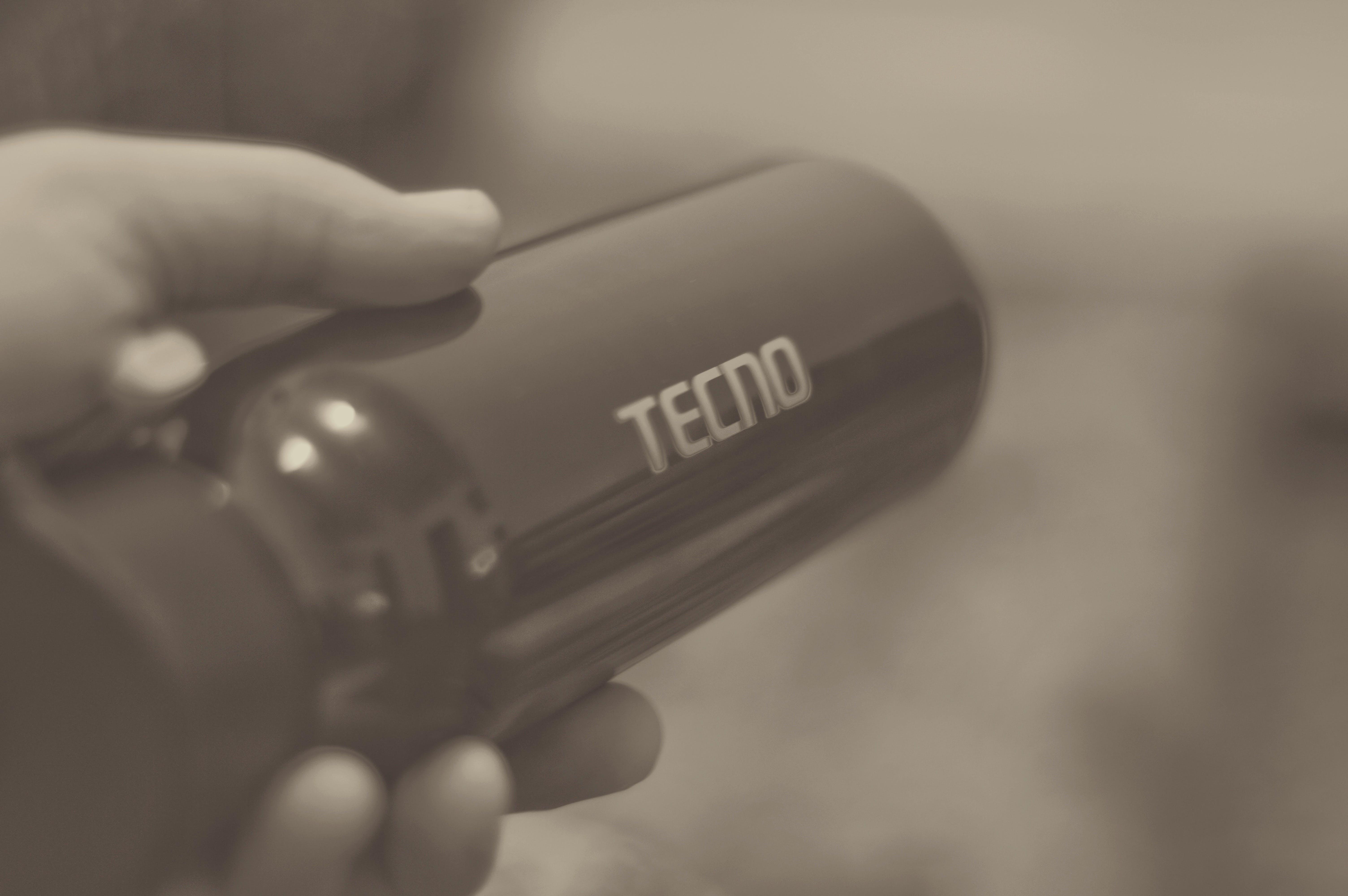 Free stock photo of black and white, bottle, hand, TECNO