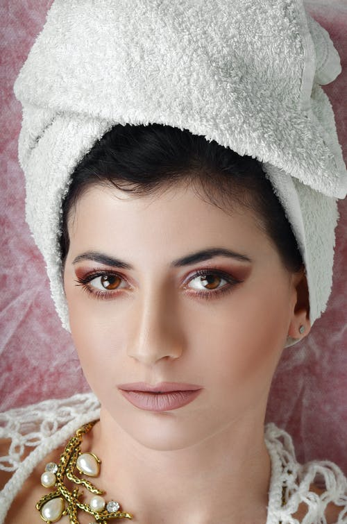 Close-Up Photo of a Beautiful Woman with Bath Towel on Her Head