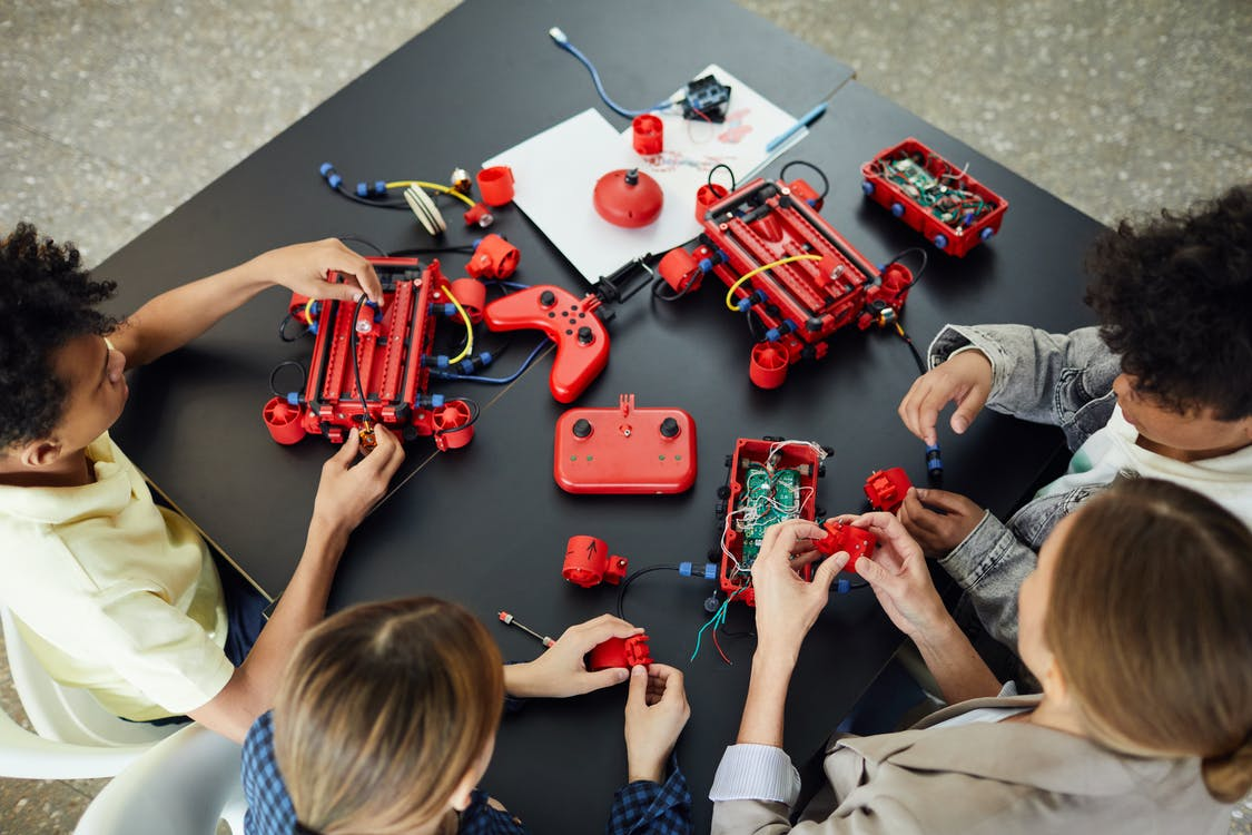 Boy in Blue Shirt Playing Red Car Toy