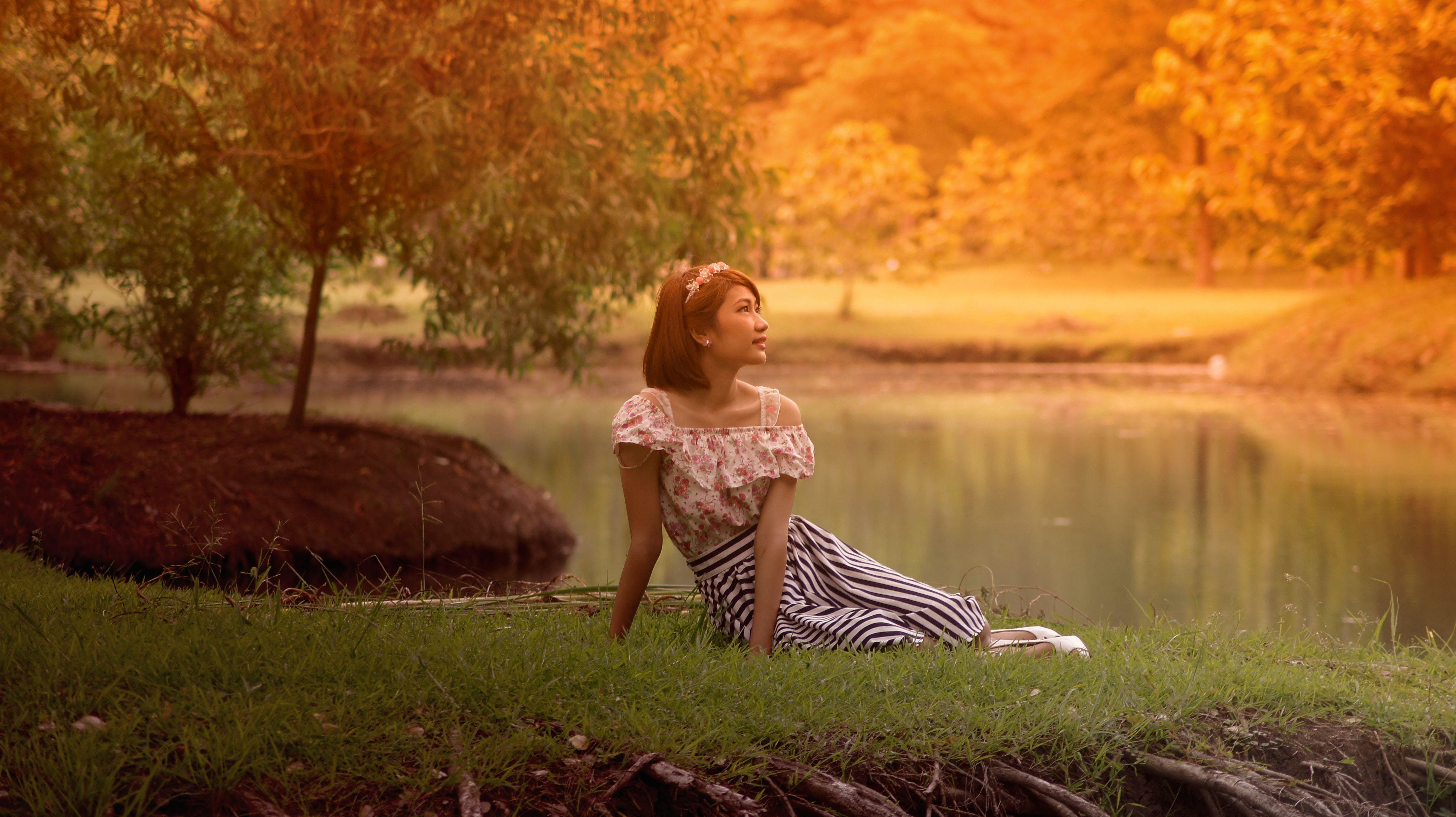 Woman in Dress Lying on Grass