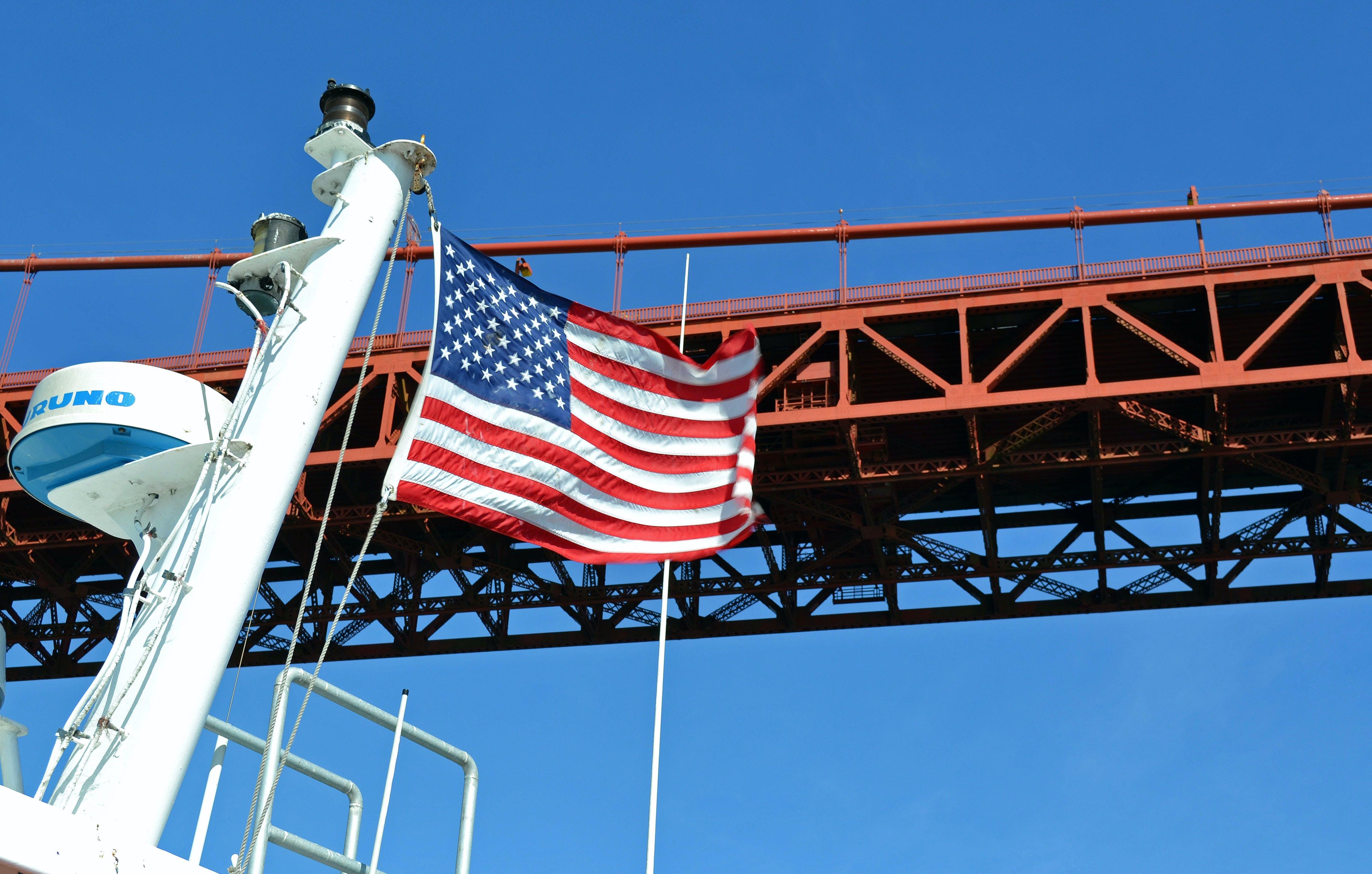 Free stock photo of American flag, california, golden gate bridge