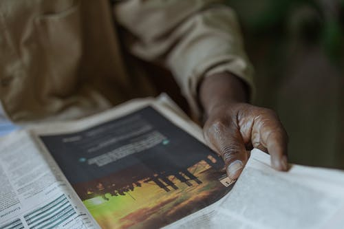 Close-Up Photo of Person Holding News Paper