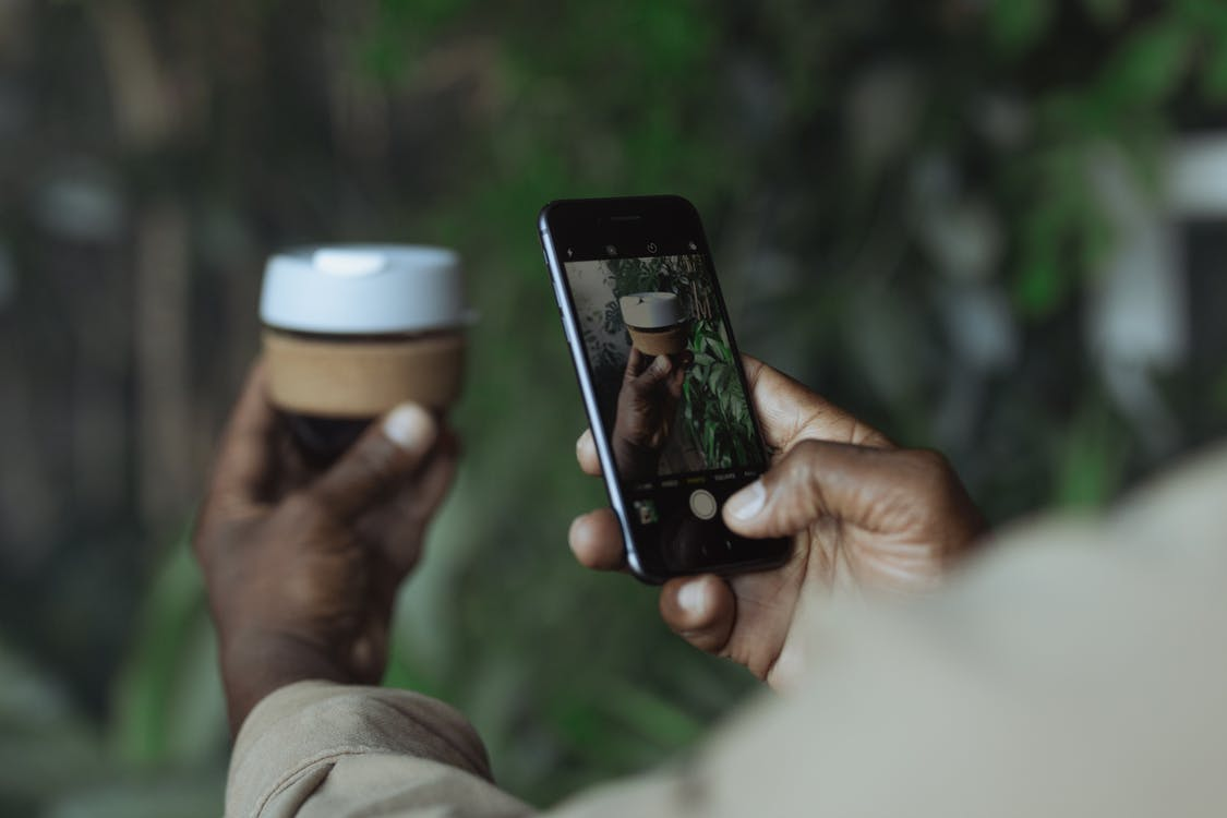 Photo of Person Taking Pictures Using Black Mobile Phone