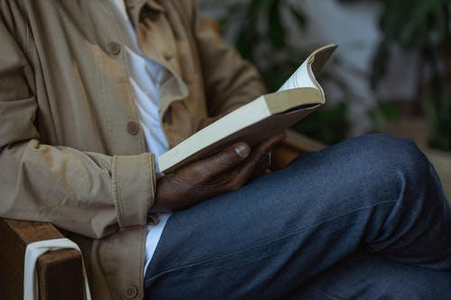 Close-Up Photo of Person Reading Book