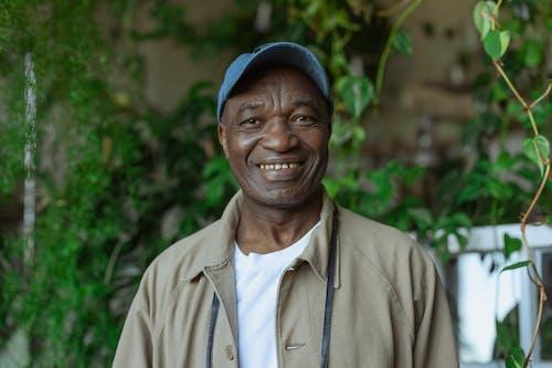 Photo of Old Man Wearing Blue Baseball Cap