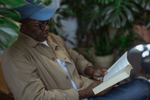 Photo of an Old Man Reading a Book