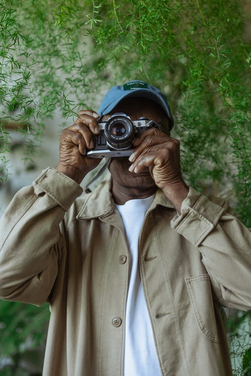 Photo of Man Using SIlver Vintage Camera