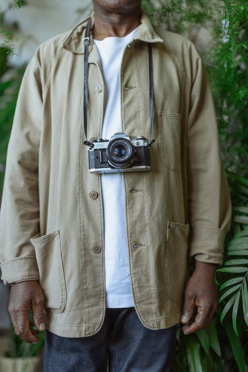 Photo of Vintage Camera Hanging on a Person