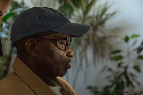 Free stock photo of baseball cap, diversity, elderly man