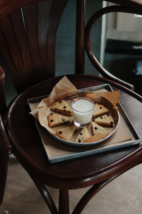 Glass of milk with delicious pie pieces in baking dish