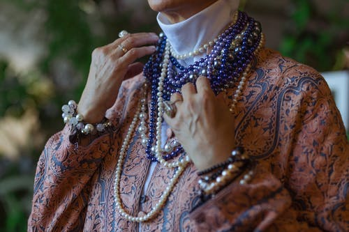 Photo Of Woman Wearing Various Necklaces