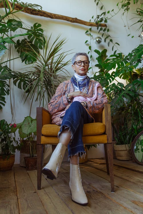 Photo of Chic Grandma Surrounded by Indoor Plants