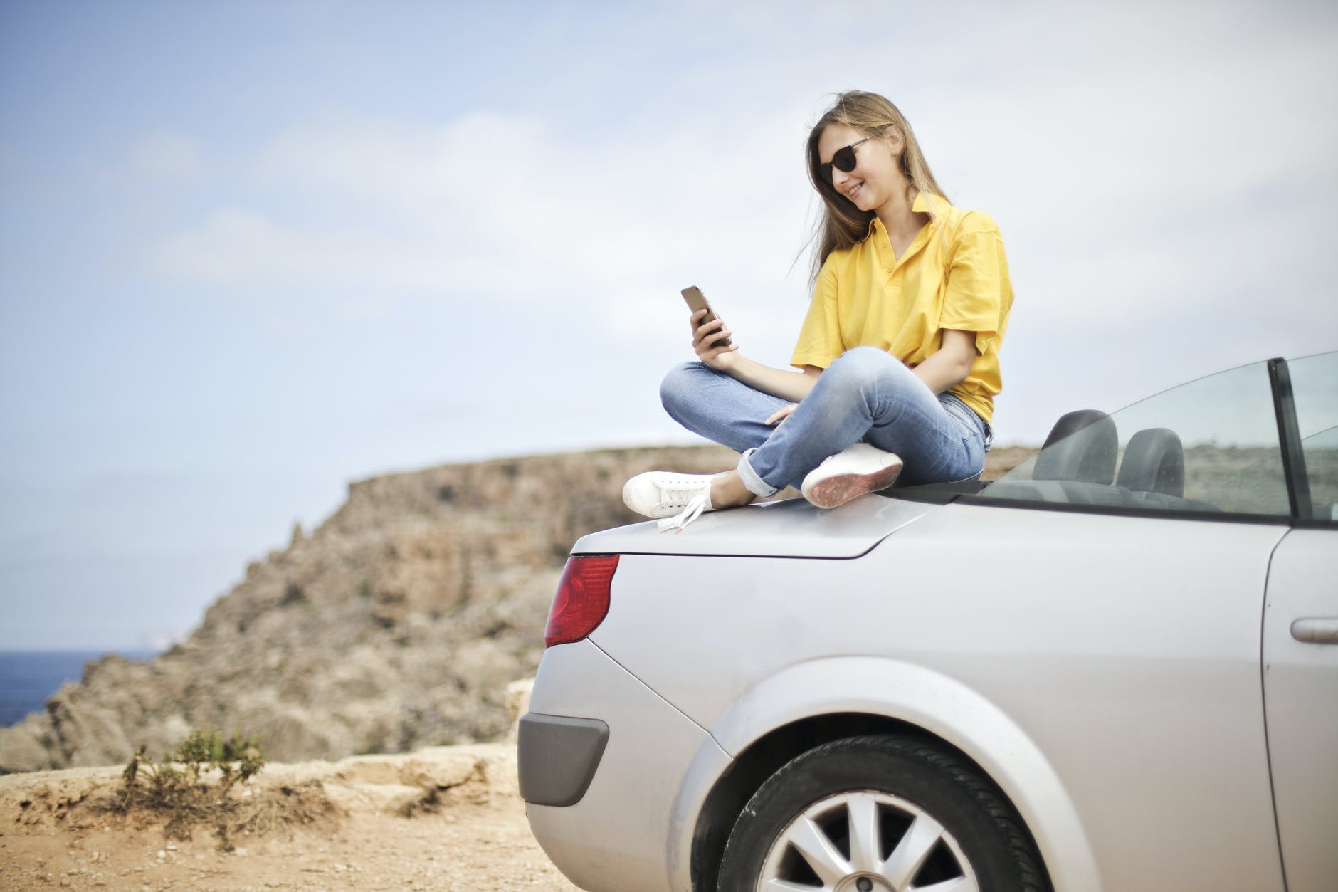 Woman On Top Of Car