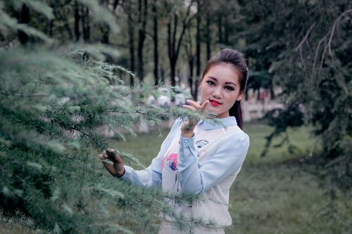 Free stock photo of black eyes, chinese girl, cypress, garden