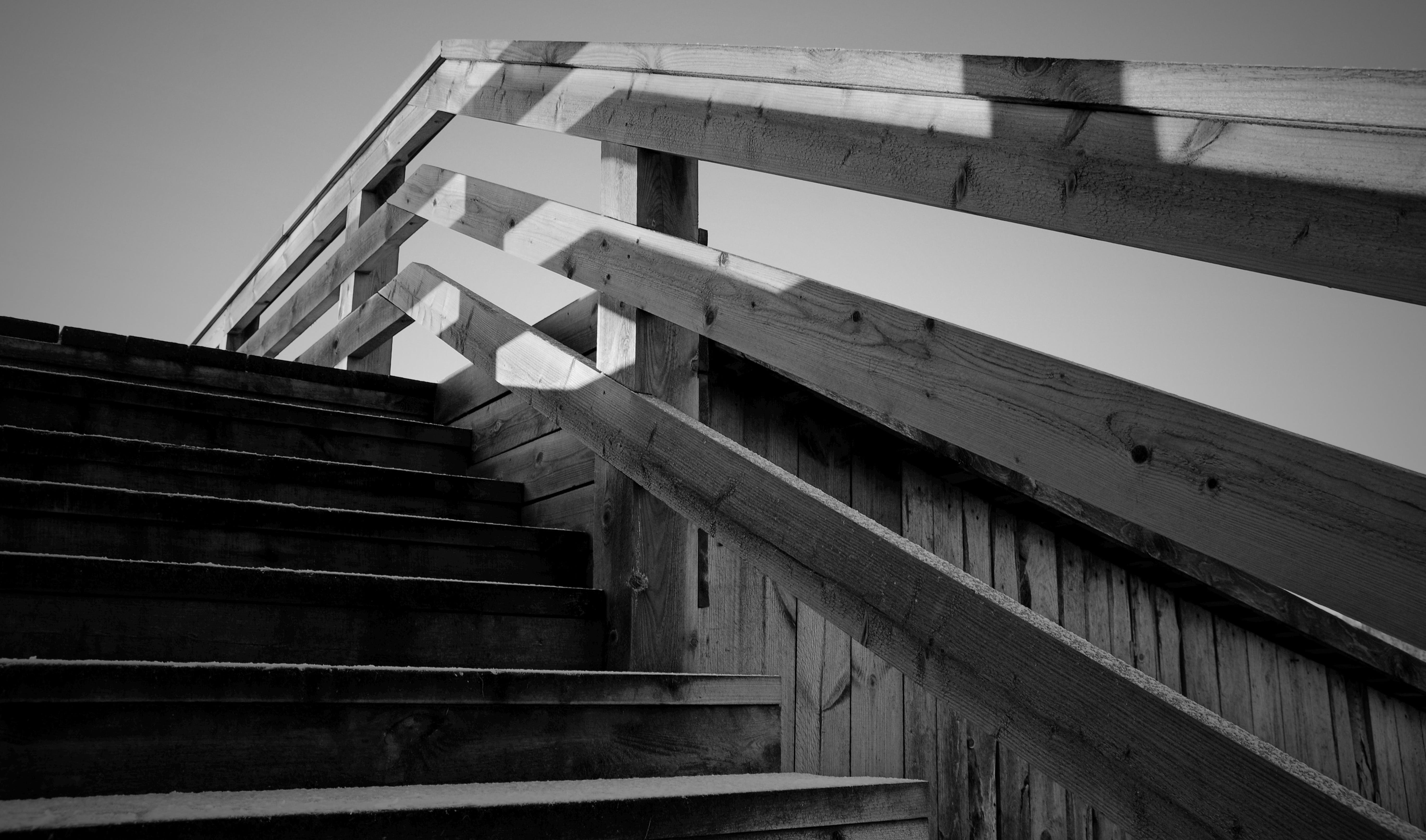 Grayscale Photo of Wooden Stairs