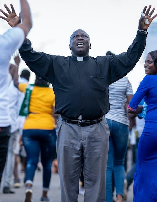 Man in Black Zip Up Jacket Raising His Hands