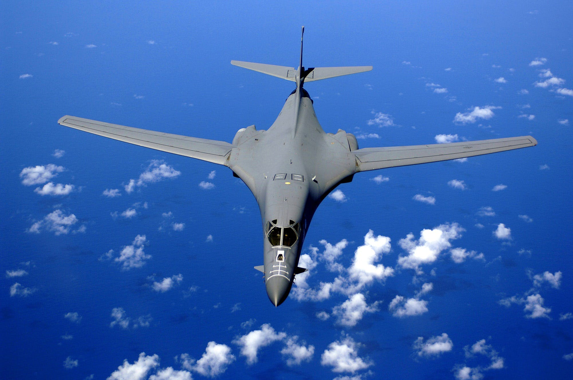 Black Fighter Jet Near White Clouds