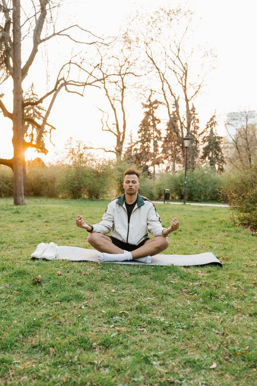 A Man Doing a Meditation in the Field During the Day