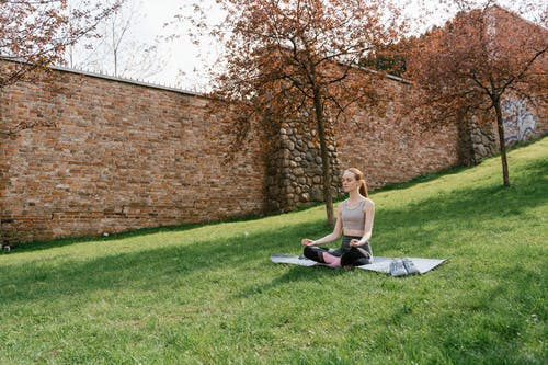 A Woman Doing a Meditation in the Field During the Day